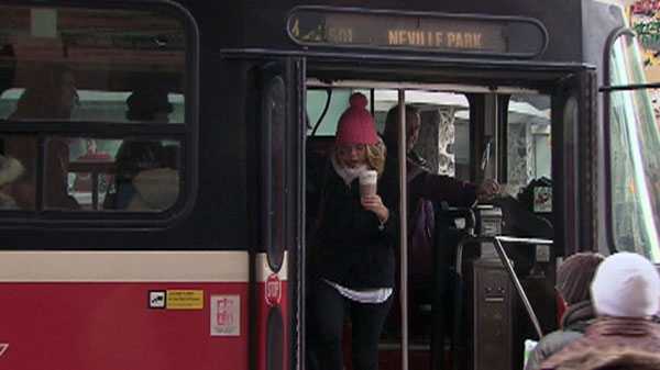 A TTC streetcar takes on passengers in downtown Toronto, Tuesday, Feb. 22, 2011.