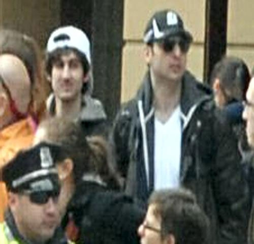 The FBI has released video surveillance images of two Boston Marathon bombing suspects. <br>Suspect number 1, wearing a black hat, was killed after a violent night that also saw a police officer killed and another injured on Friday, April 19, 2013. <br> Suspect number 2, wearing a white hat, is still on the run, and a massive manhunt is underway to find him on Friday, April 19, 2013. <br><br>Video surveillance captured one of the suspects setting down a backpack in front of a restaurant before one of the twin bombs went off,  said Special Agent in Charge of FBI&#39;s Boston Field Office Richard DesLauriers. (FBI)