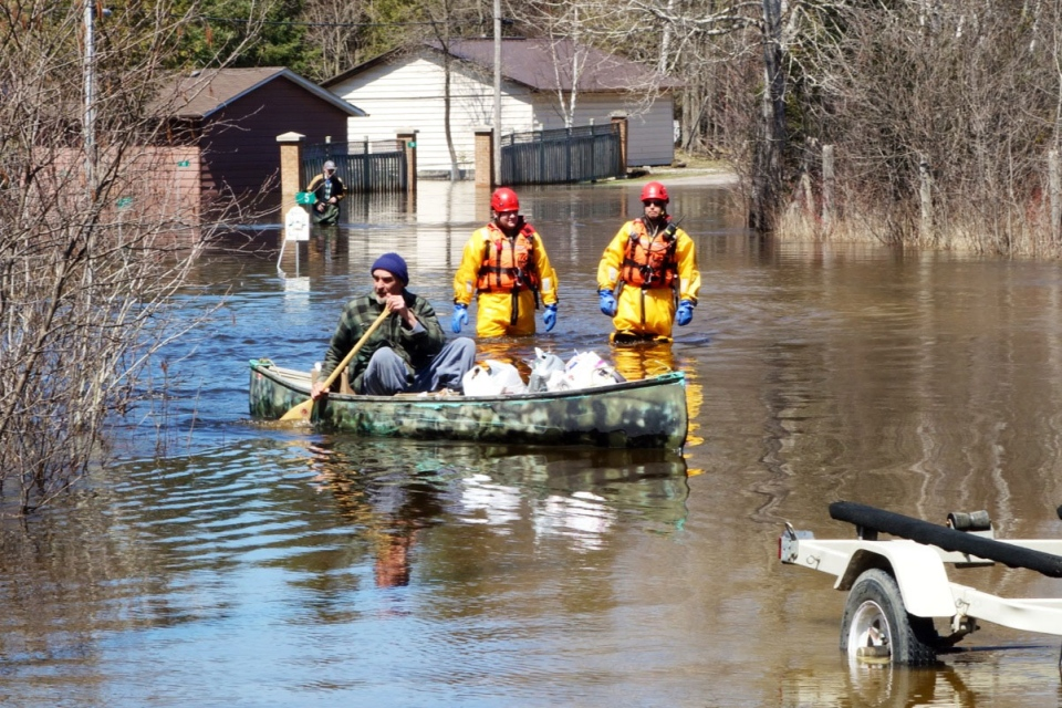 A resident of Burnt River paddles through flood waters on Sunday, April 21, 2013. (Tom Podolec / CTV Toronto)