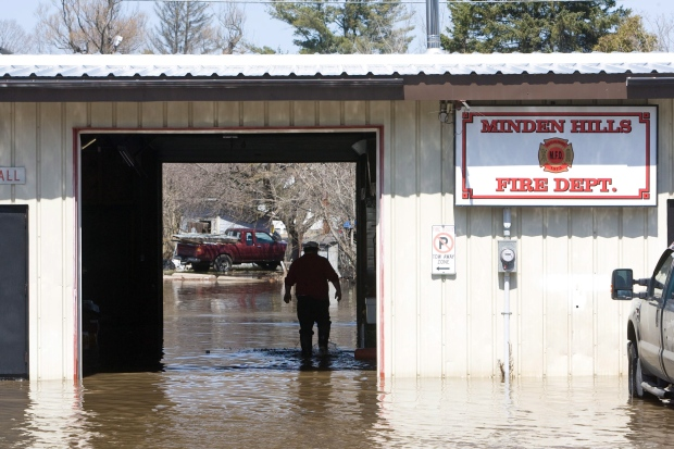 States of emergency were declared Saturday for a number of towns in Ontario&#39;s cottage country because of flooding caused by rapid snow melting and heavy rain. Many residents were evacuated from their homes over the weekend. Officials expect the waters to crest within 24 hours and allow residents back to clean up.<br><br>Firetrucks were moved to safety as the rising waters from the nearby Gull River flood the downtown section of Minden, Ont., on Monday, April 22, 2013.