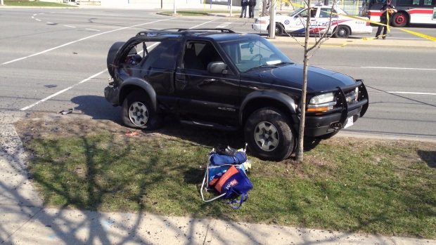 An SUV is pictured at the scene