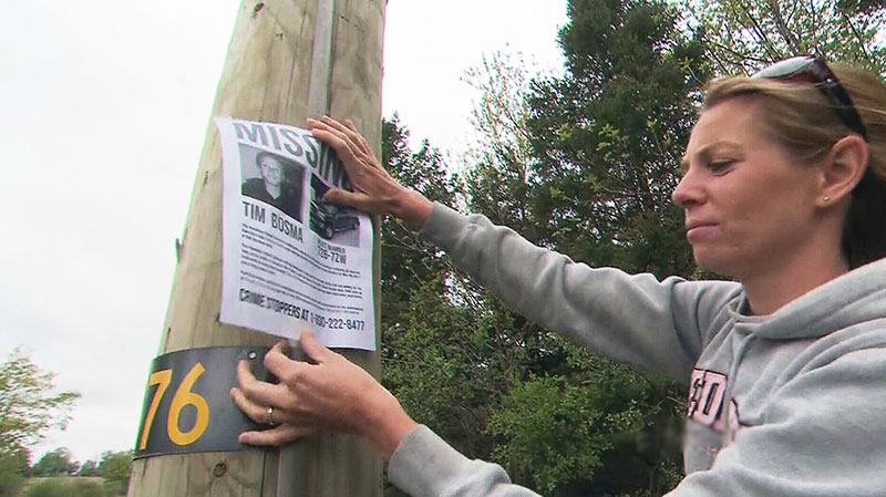 Friends, family and even strangers hand out flyers to help in search of missing Hamilton-area man on Saturday, May 11, 2013.