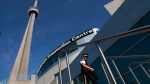 An RCMP officer patrols outside the Metro Toronto Convention Centre on Friday June 25, 2010. (Frank Gunn / THE CANADIAN PRESS)