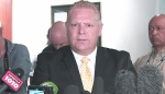 Toronto Councillor Doug Ford speaks to the media about the allegations against Mayor Rob Ford at a press conference in Toronto, Wednesday, May 22, 2013.