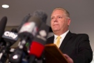 Toronto City Councillor Doug Ford reads a statement to journalists at Toronto's city hall, Wednesday, May 23, 2013. (Chris Young / THE CANADIAN PRESS)