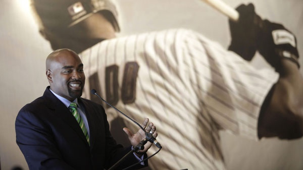 Former baseball player Carlos Delgado, of Puerto Rico, speaks to journalists after announcing his retirement in San Juan, Puerto Rico, Wednesday April 13, 2011. (AP Photo/Ricardo Arduengo)