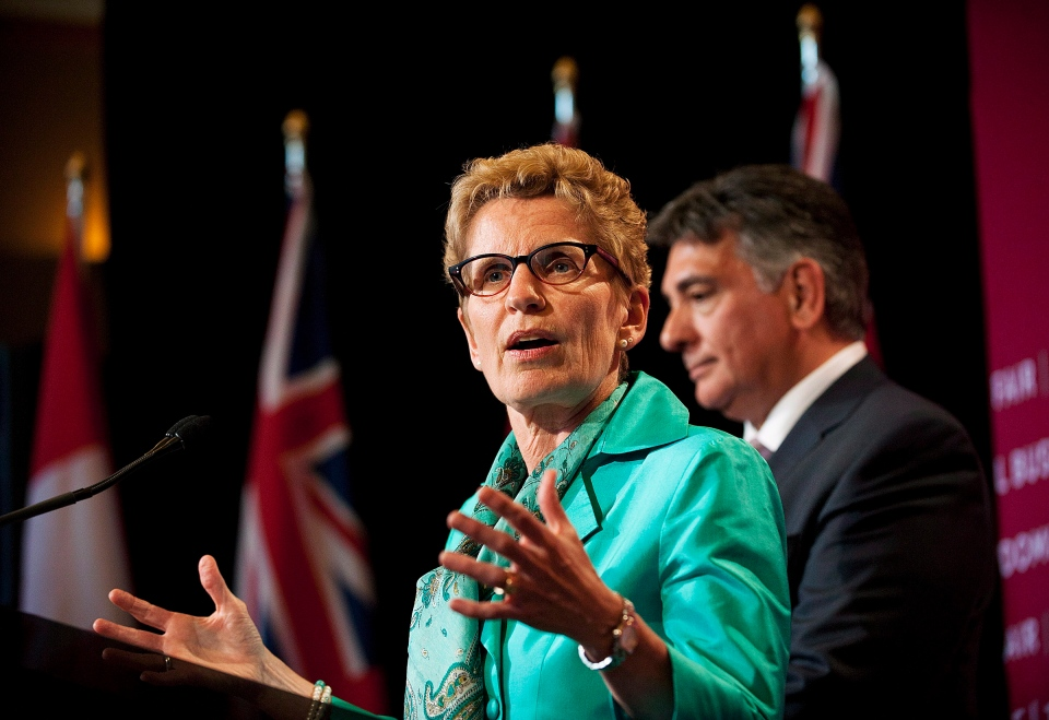 Ontario Premier Kathleen Wynne speaks about the budget alongside Finance Minister Charles Sousa at Queens Park in Toronto on Tuesday, June 11, 2013. (Aaron Vincent Elkaim / THE CANADIAN PRESS)