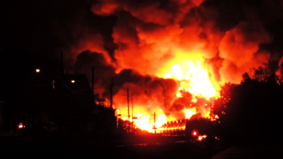 Balls of flames shot several metres into the air after a train carrying crude oil derailed in the Quebec town of Lac-Megantic early Saturday, sparking several explosions.