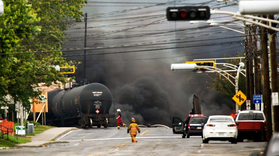Smoke rises from railway cars that were carrying crude oil after derailing in downtown Lac Megantic, Quebec, Canada, Saturday, July 6, 2013. (AP / Paul Chiasson)