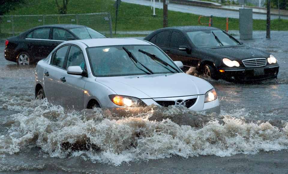 Cars attempt to turn off Lakeshore Boulevard in Toronto on Monday, July 8 2013. (THE CANADIAN PRESS)