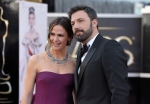 Actors Jennifer Garner, left, and Ben Affleck arrive at the Oscars at the Dolby Theatre on Sunday Feb. 24, 2013, in Los Angeles. (John Shearer / AP)