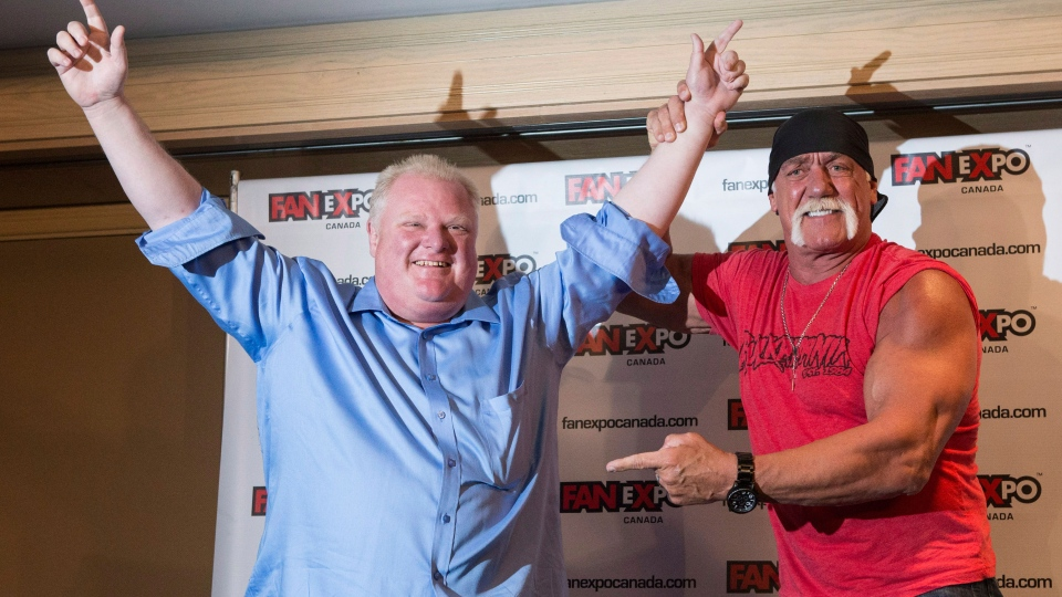 Toronto City Mayor Rob Ford (left) celebrates after beating Hulk Hogan in an arm-wrestling match to promote Fan Expo in Toronto on Friday August 23, 2013. (Chris Young / THE CANADIAN PRESS)