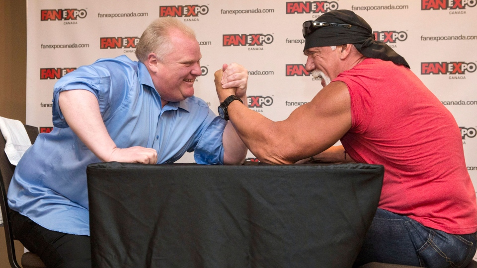 Toronto City Mayor Rob Ford (left) takes on Hulk Hogan in an arm-wrestling match to promote Fan Expo in Toronto on Friday August 23, 2013. (Chris Young / THE CANADIAN PRESS)