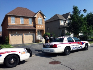 Police at the home of a young couple who have been charged with the second degree murder of their one-month-old child, in Markham, Wednesday, Aug. 28, 2013. (Tom Podolec / CTV Toronto)