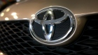 A Toyota logo is seen on the front of a vehicle. (AP Photo/Jeff Chiu)