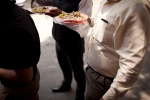 Office workers eats tacos at an outdoor food stand during lunch time in Mexico City on July 10, 2013. (AP Photo/Ivan Pierre Aguirre)