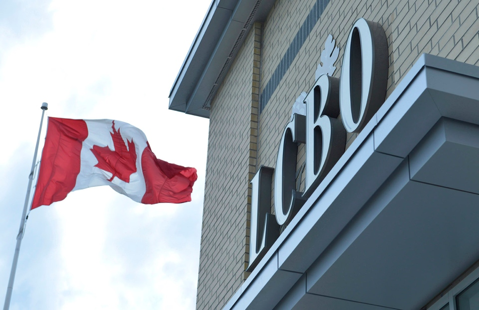 A Canadian flag flies near an under construction LCBO store in Bowmanville, Ontario on Saturday July 20, 2013. (The Canadian Press/Doug Ives)