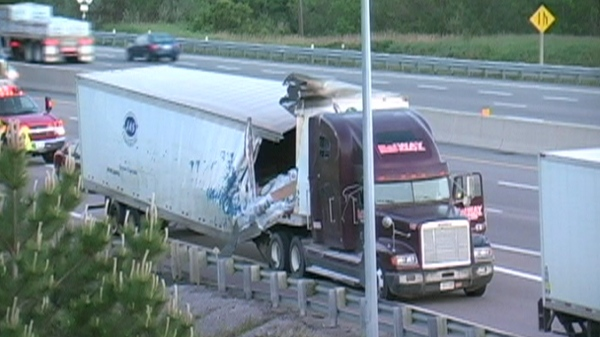 A man has been arrested after a tractor-trailer heading eastbound on Highway 401 crashed near Port Hope early Friday, June 3, 2011.