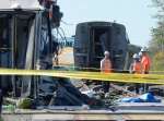 6 people killed after bus and train collide in Ottawa<br><br> Officials investigate at the scene of a Via Rail train and city bus collision in Ottawa&#39;s west end Wednesday, Sept. 18, 2013. Six people died and more than 30 were injured when the bus slammed into the train after going through a safety barricade. (Adrian Wyld / THE CANADIAN PRESS)