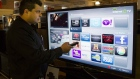 Sami Smidi demonstrates an Internet capable TV Wednesday, Jan. 12, 2011, in Montreal. (The Canadian Press/Ryan Remiorz)