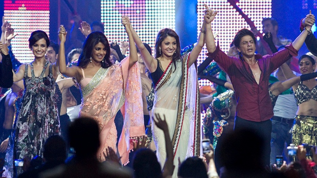 From left to right, Diya Mirza, Priyanka Chopra, Anushka Sharma, and Shah Rukh Khan acknowledge the fans while on stage at the 2011 International Indian Film Academy Awards in Toronto early Sunday morning, June 26, 2011. (THE CANADIAN PRESS/Chris Young)