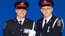 In this police handout photo, York Regional Police Const. Garrett Styles is seen with his father, retired Staff Sgt. Garry Styles at his badge ceremony in 2004.