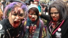 A zombie trio is unimpressed with having a photo taken during the Toronto zombie walk on Saturday, Oct. 26, 2013. (Patricia Jaggernauth / CP24)