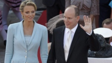 Prince Albert II of Monaco waves with his bride Charlene Princess of Monaco outside the Monaco palace, after the civil wedding marriage ceremony, Friday, July 1, 2011. (AP Photo/Lionel Cironneau, Pool)