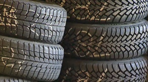 A tire store owner and her son have been charged after snow tires valued at more than $50,000 were reported stolen from Oshawa-area car dealerships.