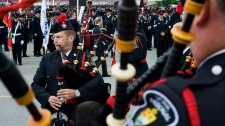 York Regional Police Bag Pipers are play at the Upper Canada Mall in Newmarket, Ont., prior to the funeral procession for Constable Garrett Styles on Tuesday, July 5, 2011. (Aaron Vincent Elkaim / THE CANADIAN PRESS)