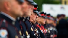 Toronto Police are seen in formation at the Upper Canada Mall in Newmarket, Ont., during the funeral procession for Constable Garrett Styles on Tuesday, July 5, 2011. (Aaron Vincent Elkaim / THE CANADIAN PRESS)