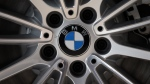 In this file photo, the company logo of car manufacturer BMW is pictured on a car in Munich, Germany, Tuesday, March 19, 2013. (AP / Matthias Schrader)