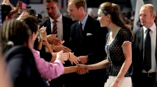 Prince William and Kate, the Duke and Duchess of Cambridge, greet fans as they arrive at the Mission Serve Hiring Our Heroes Los Angeles job fair for veterans and military spouses held at the Sony Pictures Studios in Culver City, Calif., Sunday, July 10, 2011.