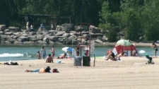 Sun lovers enjoy the beach at Ashbridges Bay in Toronto, Thursday, July 21, 2011.