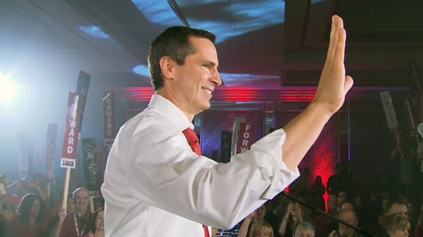 Ontario Premier Dalton McGuinty waves to supporters at a Liberal Rally in Richmond Hill, Ont., Sunday, June 24, 2011.
