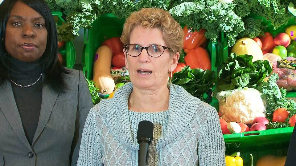 Ontario Premier Kathleen Wynne announces more than $200,000 in gift cards will be given to those impacted by the ice storm, in Toronto, Monday, Dec. 30, 2013.