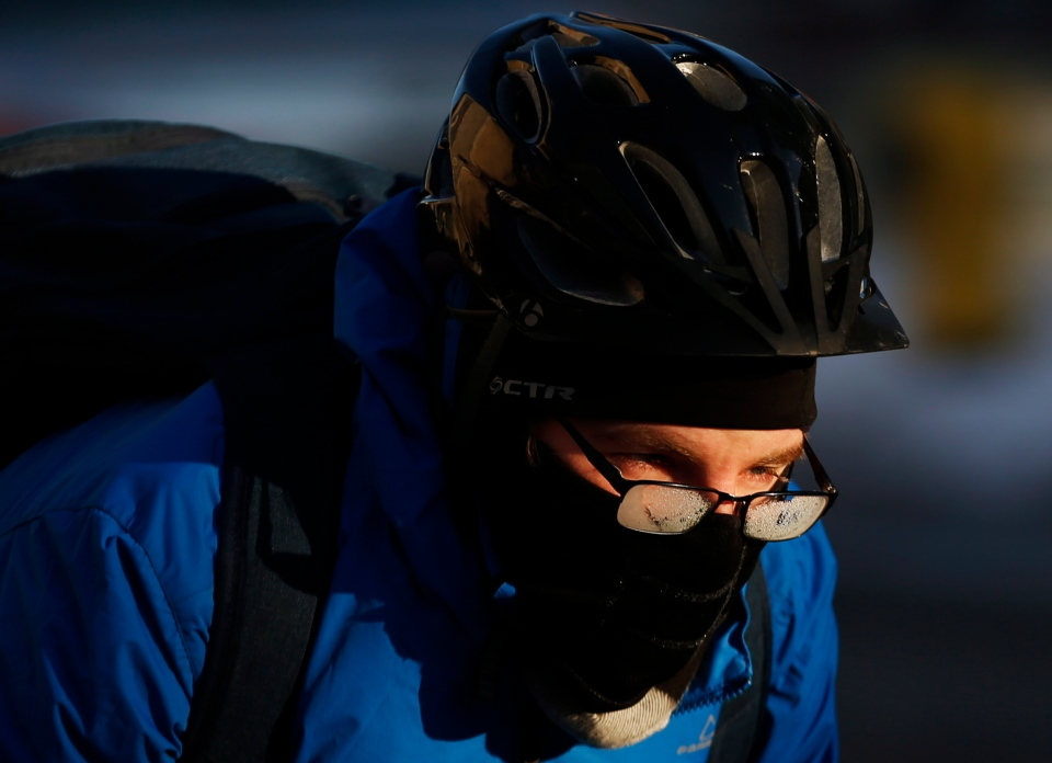 A cyclist peers over his frozen glasses in -20C temperatures in Toronto, Tuesday, Jan. 7, 2014. (Mark Blinch / THE CANADIAN PRESS)