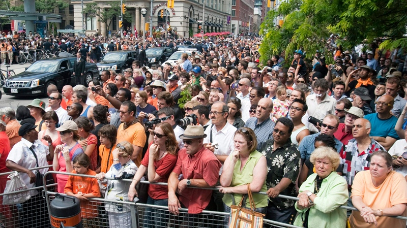 People crowd outside Roy Thomson Hall ahead of funeral services for NDP leader Jack Layton in Toronto on Saturday, Aug. 27, 2011. (Ryan Remiorz / THE CANADIAN PRESS)