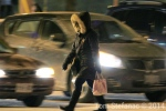 A woman crosses the street during an extreme cold weather alert in Toronto on Tuesday, Jan. 21, 2014. (Tom Stefanac/CP24)