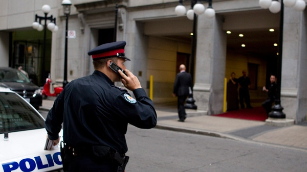 A police officer stands outside an apartment in Toronto after former NHL player Wade Belak was found dead on Wednesday, Aug. 31, 2011. (Chris Young / THE CANADIAN PRESS)