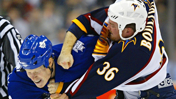 Toronto Maple Leafs Wade Belak (left) and Atlanta Thrashers Eric Boulton spar during the first period in NHL action in Toronto on Saturday, Nov. 19, 2005. (Adrian Wyld / CP PHOTO)