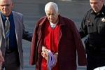 In this Jan. 10, 2013 file photo, former Penn State University assistant football coach Jerry Sandusky, center, leaves the Centre County Courthouse after attending a post-sentence motion hearing in Bellefonte, Pa. (AP Photo/Gene J. Puskar, File)