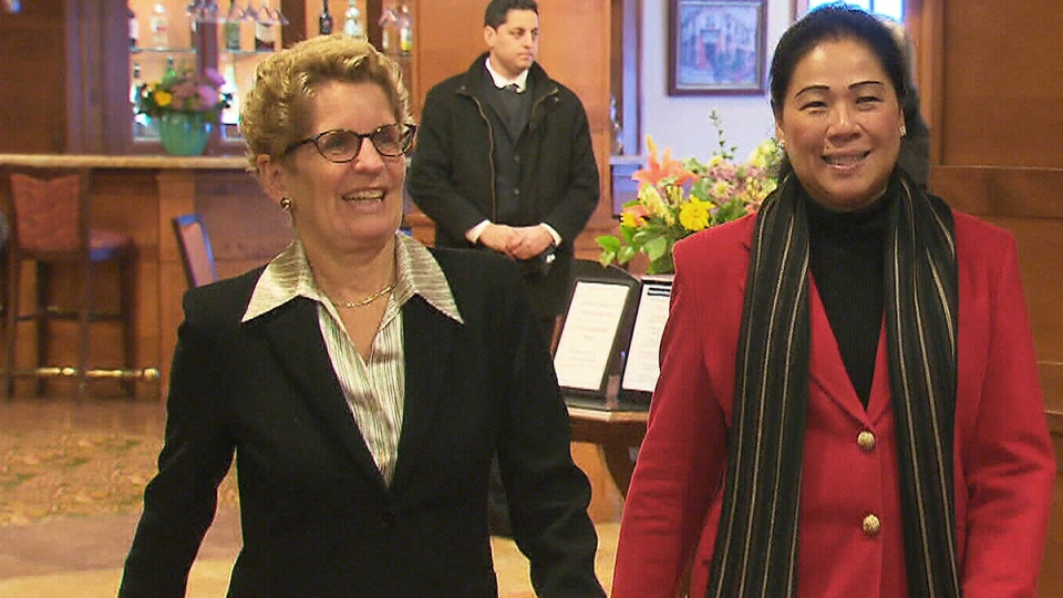 Ontario Premier Kathleen Wynne walks with Liberal candidate Sandra Yeung Racco at the Thorne Mill on Steeles retirement home, in Toronto, Monday, Jan. 27, 2014.
