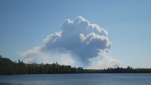 This photo provided by Visit Duluth Public Relations, smoke fills the sky from a fire outside the borders of the Boundary Waters Canoe Area near Ely, Min. on Sept. 11, 2011. The Pagami Creek forest fire has more than tripled in size since Sunday and has grown to cover more than 16,000 acres. The blaze has forced Lake County and Superior National Forest officials to close several county and Forest Service roads north of Minnesota Highway 1 between Ely and Isabella. Some residents and campers are being asked to evacuate the area. (AP Photo/Visit Duluth Public Relations, Gene Shaw)