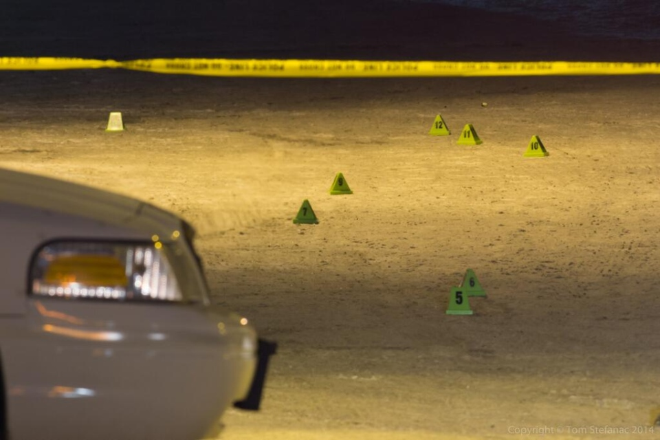 Evidence markers are placed on the ground at the scene of a fatal stabbing on Kendleton Drive early Thursday, Feb. 13, 2014.