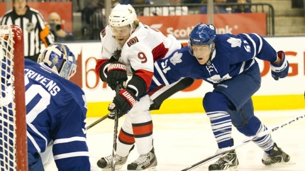 Toronto Maple Leafs Jake Gardiner (right) breaks up the play as Ottawa Senators Milan Michalek (9) closes in on goaltender Ben Scrivens during third period NHL pre-season action in Toronto on Monday September 19, 2011.