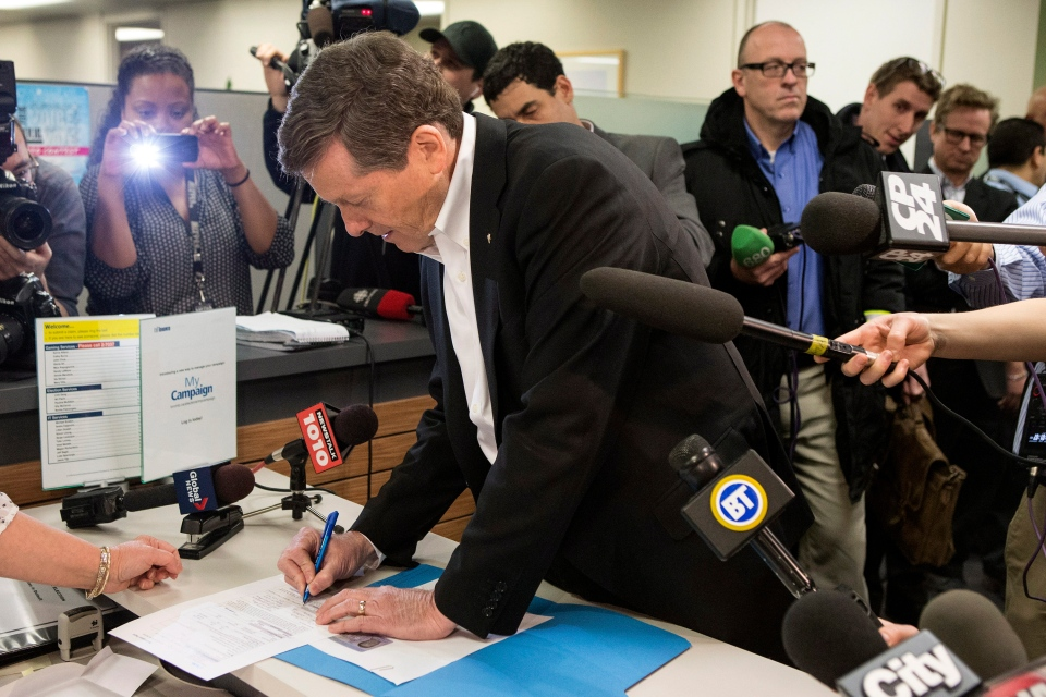 Former Ontario PC Leader John Tory signs his nomination paper as he formally enters the race for Toronto's Mayoral Election at Toronto City Hall on Monday, Feb. 23, 2014. (Chris Young / THE CANADIAN PRESS)