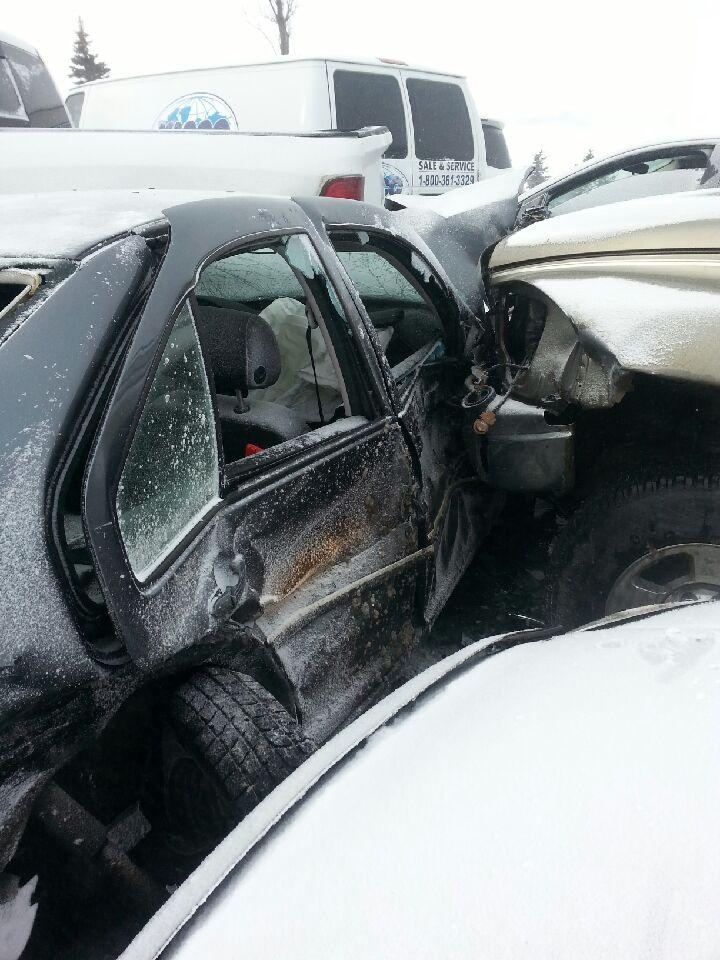 Two vehicles are wedged together following a multi-vehicle collision on Highway 400 on Thursday, Feb. 27, 2014. (Source: Joe Battisti)