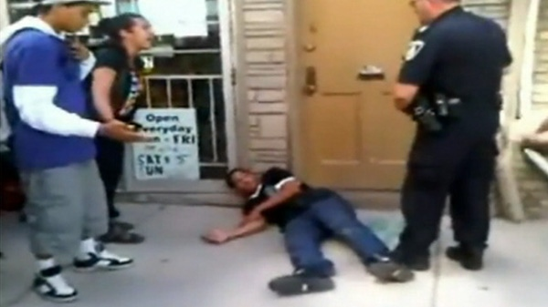 This images taken from cellphone video posed on YouTube shows a teen after he was Tasered by a police officer in London, Ont., on Thursday, Sept. 22, 2011.