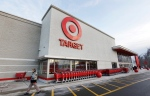 A passer-by walks near an entrance to a Target retail store in Watertown, Mass., in this Dec. 19, 2013, file photo.  (AP / Steven Senne)